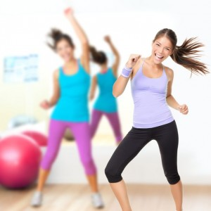 12935351 - fitness dance studio class. dancing woman in gym during exercise dancer workout training with happy fresh energy.